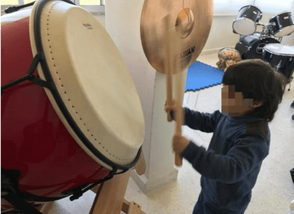 music therapy percussion children playing drums instrument